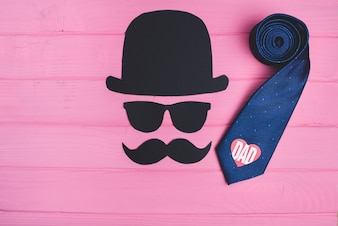 Pink wooden background with necktie for father's day