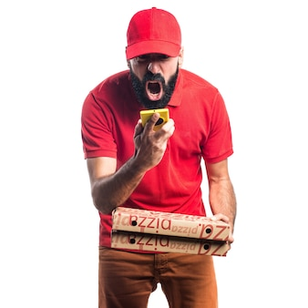 Pizza delivery man holding a mobile