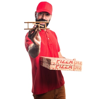 Pizza delivery man holding a wooden toy airplane