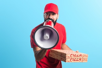 Pizza delivery man shouting by megaphone on colorful background