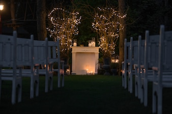 Place for wedding altar made of cosy fireplace and candles