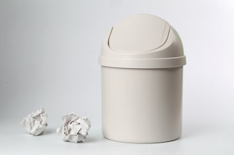 Plastic trash can on white background