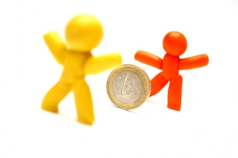 Plasticine figures with a coin
