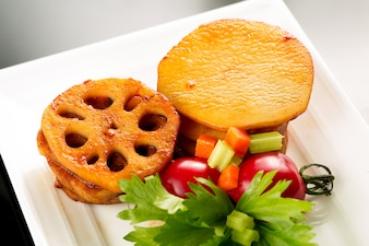Plate of fried potatoes with garnish