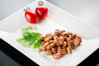 Plate og peanuts with garnish