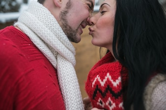 Playful couple kissing gently