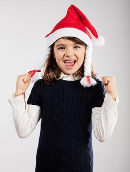 Playful girl wearing a santa hat