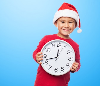 Playful kid with a clock