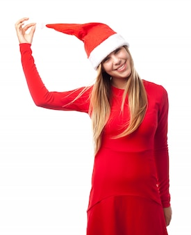 Playful teen with a santa hat