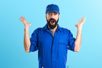 Plumber doing surprise gesture on colorful background