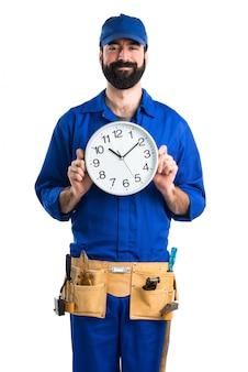 Plumber holding clock