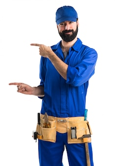 Plumber pointing to the lateral