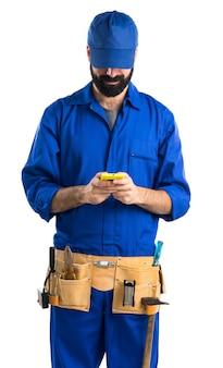 Plumber talking to mobile