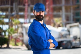Plumber with his arms crossed on unfocused background