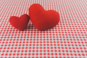 Plush hearts on a checkered tablecloth