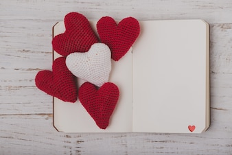 Plush hearts on an open book