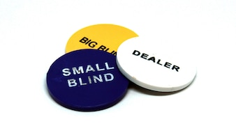 Poker dealer small and big blind chips