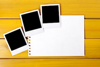 Polaroid photo prints with a page