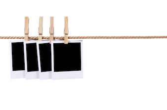 Polaroid photos on a rope