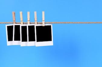 Polaroid style photos on a string