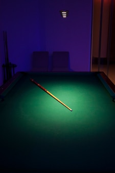Pool table with a stick