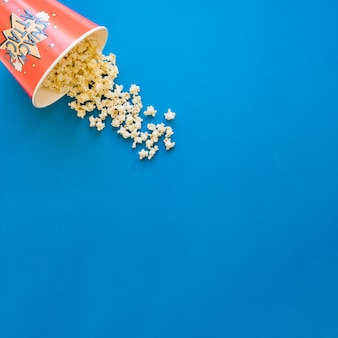 Popcorn on blue background with space on right