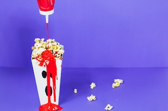 Popcorn with blood-like sauсe