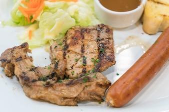 Pork steak with sausage