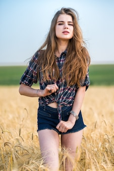 Portrait of a beautiful girl in a field