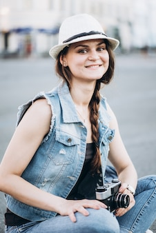 Portrait of a smiling tourist girl