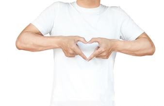 Portrait of a young man doing a heart gesture against a white background