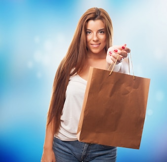 Portrait of a young woman holding a shopping bag