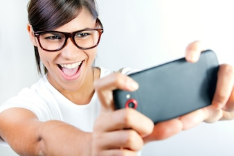 Portrait of beautiful young woman with mobile.