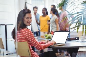 Portrait of business executive using laptop