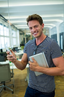 Portrait of business executive using mobile phone