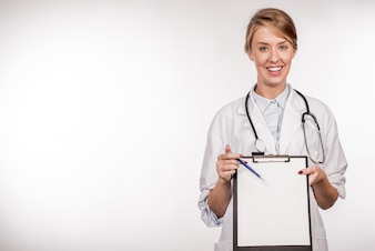 Portrait of confident young medical doctor holding a clipboard