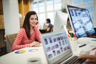 Portrait of graphic designer working at her desk