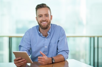 Portrait of happy businessman with tablet pc