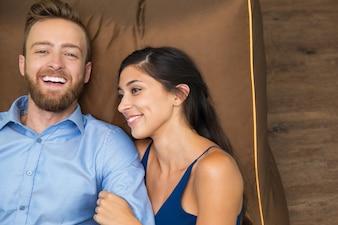 Portrait of happy couple spending time on sofa