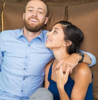 Portrait of happy young loving couple at home
