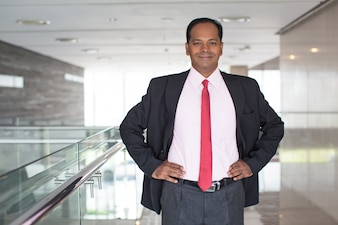 Portrait of smiling Indian businessman in office