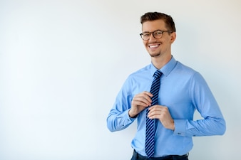 Portrait of smiling young businessman in glasses