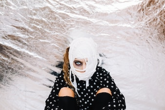 Portrait of woman with bandaged face