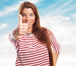 Positive woman showing thumb up