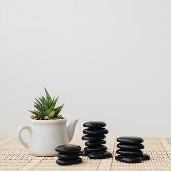 Pot next to three piles of stones