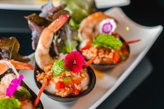 Prawns placed on small plates