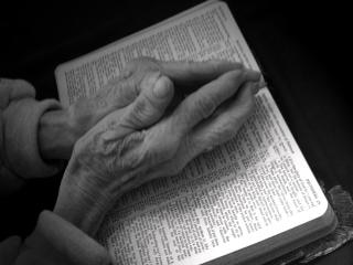Praying Hands on Bible - Black and White