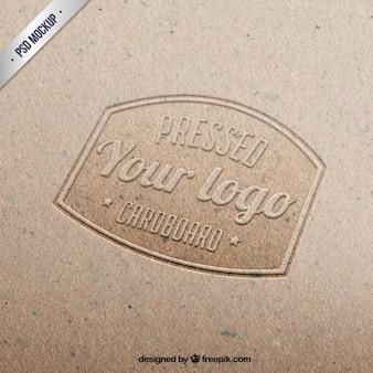 Pressed logo on cardboard