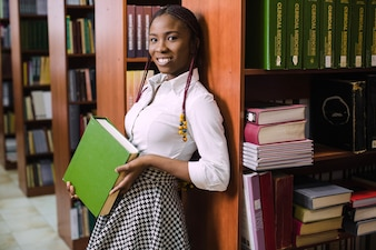 Pretty black girl with book