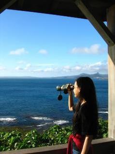 Pretty Girl Looking through Binoculars